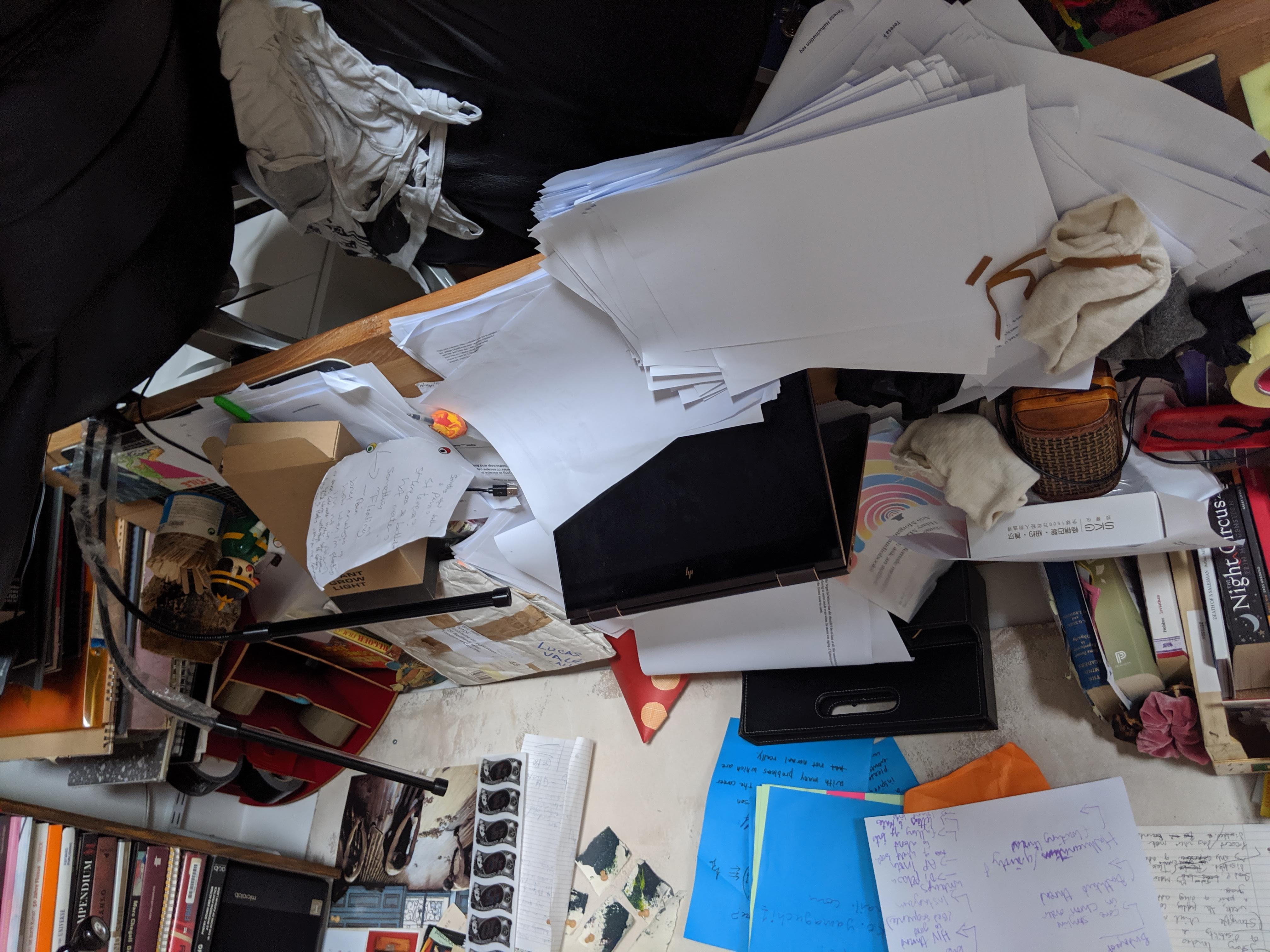 Photograph of messy writing desk in Abi Palmer's flat